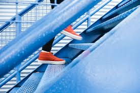 7 things you should do to get a promotion sound telecom blog image of a person ascending a staircase since they have learned how to get a promotion