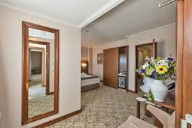 family room deluxe guestroom showing item 40 of 96 suite 1 double or 2 single beds guestroom bekdas hotel deluxe istanbul interior entrance