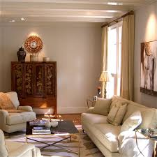 living room with bed: most popular interior paint colors family room traditional with animal print area rug