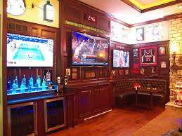 stunning bridgetown sports barin the family room traditional home basement sports bar ideas