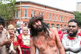 annual passion of christ re enactment draws thousands an actor portraying jesus stumbles in pain at the passion of christ procession