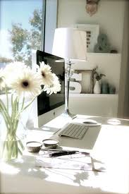 a beautiful bright office space the window light and flowers really help set a natural beautiful bright office