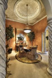 style dining room paradise valley arizona love: love this room dont like those printed chairs though tuscan style dining room with round plush area rug paradise valley arizona rugsmart interiors