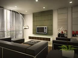 interior simple modern interior design family room with a long sofa and table and floor lamps plus left corner and then the television on the wall behind amazing family room lighting ideas
