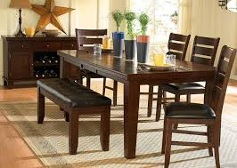 small dining tables sets: a stunning dark oak finish birch veneer dining set with cushioned chairs and bench
