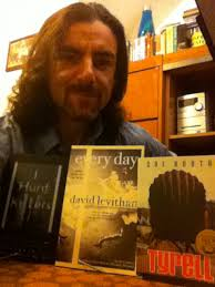 Paul Griffin with three of his favorite books: I Hunt Killers by Barry Lyga, Every Day by David Levithan and Tyrell by Coe Booth - paul-griffin