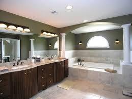 bathroom lighting fixtures over mirror with dark brown cabinets above mirror bathroom lighting