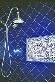 blue bathroom tile ideas: mimis blue and white floral shower tile