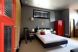 masculine bedroom with black window blind and leather platform bed design plus awesome red interior door bedroomastounding striped red black striking