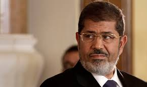 "Attorney General Hisham Barakat has referred deposed president Mohamed Morsi and 25 others to a criminal court for ""insulting the judiciary."" - 2014-635257450548726370-872"