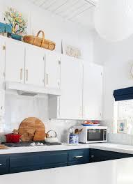 blue kitchens navy kitchen walls kitchen after emily henderson blue white brass countertops cabinets