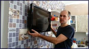 Как закрепить жк или плазменный телевизор к стене через ...