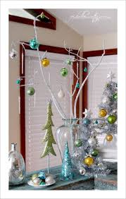 cheap christmas decor: dont have the space for a massive fir but still want to hang a few ornaments with cheer then grab a few branches paint them white and stuff them in a