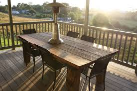 vintage wooden railing banister designed around patio with rustic outdoor dining table set furniture charming outdoor furniture design