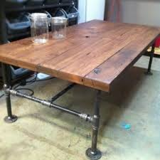 barn wood cast iron pipe coffee table will be perfect for the kids an i black iron pipe table