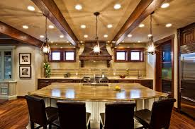 light and bright kitchen with exposed beam vaulted ceilings beams lighting