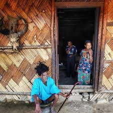 meeting the last surviving headhunters of nagaland global konyak people outside their traditional houses