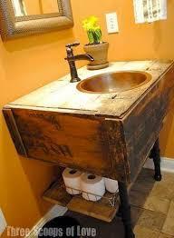 making bathroom cabinets: salvaged wood and industrial pipe fitting diy bathroom vanity