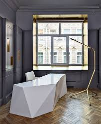 the chic basic ramblas hotel has one of the most imaginative reception desks weve seen so far its made out of suitcases of different shapes and sizes chic front desk office interior design ideas
