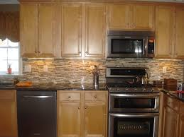 kitchen interior stone countertop glass  beige glass tile pattern backsplash kitchen brown varnished wood kitc