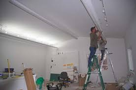 studio lights being installed artist studio lighting