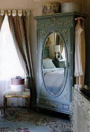 amusing vintage style interior design bedroom as well as cupboard corner plus oval mirror on door blue vintage style bedroom