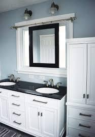 sliding bathroom mirror: beautiful master bathroom renovation white with dark countertops and a smart sliding mirror over