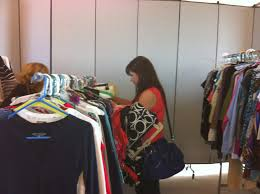 dress for success offers inexpensive clothes at inventory a shopper looks through clothes at a dress for success in the spring a