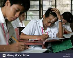 students answer test questions at a state high school in manila the require all senior secondary students to take the annual national career assessment examination ncae to determine