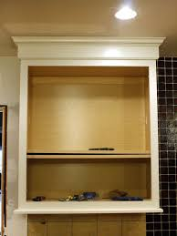 diy how to install a kitchen cabinet light rail this rail hides the lighting cabinet lighting diy