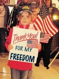 enter essay contest to win war memorial trip vets times union a youngster welcomes back veterans from a recent patriot flight at the albany international airport