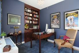 rich blue walls home office with book shelves blue office walls