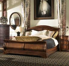premium finish cal king sleigh bed set designs features earth brown solid wood curved headboard and brown solid wood furniture