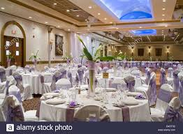 Round Function Tables Indoor Wedding Reception Hall With Round Tables And Flower Stock