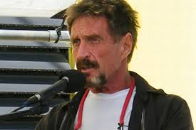 Software company founder John McAfee has revealed he is in hiding with a young woman and changing locations to elude police. - John%2520McAfee%2520seen%2520speaking%2520in%2520San%2520Pedro,%2520Belize