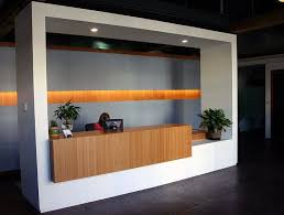 elevate your office reception desk with amber grain plyboo bamboo chic front desk office interior design ideas