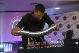 you want to be a bartender  just wait      daily monitora bartender demonstrates his skills in mixing
