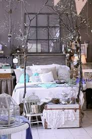 kitty otoole elegant whimsical bedroom: the branches she used as bed posts are so romantic and whimsical and i love the bird theme throughout the display she put little wooden cages at the foot