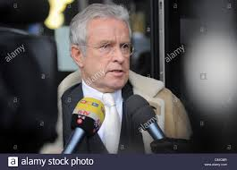 the new lawyer of weather presenter joerg kachelmann johann stock photo the new lawyer of weather presenter joerg kachelmann johann schwenn gives an interview during a break on the 17th day of trial in front of