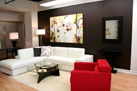 simple living room decorating ideas with beautiful wall painting and l shaped white vinyl sofa which has track arm as well as padded seat cushion also round beautiful simple living