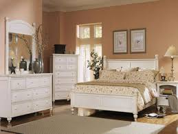 plain salmon wall paint color background paired with white bedroom furniture design also cream rug idea bedroom ideas white furniture