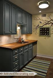 painted blue kitchen cabinets house: kitchen makeover painted cabinets in a lovely color cabinet color hallowed hush by behr home depot interior oil based paint in a satin finish