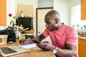 pnc virtual wallet online banking review man paying bills online