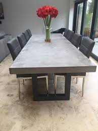 chunky dining table and chairs polished chunky concrete dining table with industrial by breuhaus