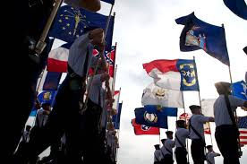 u s department of defense photo essay basic trainees on the parade grounds holding state flags during their graduation ceremony on lackland