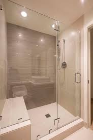 this modern bathroom has a large glass enclosed shower in tile the shower stall bathroom recessed lighting bathroom modern