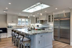sailing and pailing large transitional l shaped eat in kitchen photo in orange county with glass spacious eat kitchen