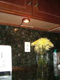 this under cabinet light was installed in less than an hour it really does a cabinet lighting pucks