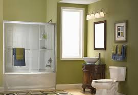 traditional room using track bathroom lighting ideas above classic maple vanity and white sink bathroom lighting ideas bathroom traditional