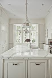 calacatta marble kitchen waterfall: calcutta marble on island and pendants are to die for